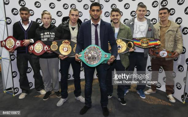 Amir Khan poses for photographers with 2012 belt winners from Gallaghers Gym Amateur boxers Ali Tawfik Danny Longworth with professional boxers Scott...