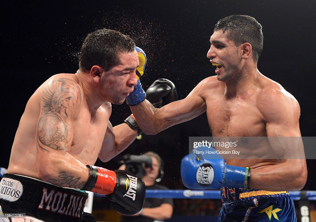 <a gi-track='captionPersonalityLinkClicked' href=/galleries/search?phrase=Amir+Khan+-+Boxer&family=editorial&specificpeople=162795 ng-click='$event.stopPropagation()'>Amir Khan</a> punches Carlos Molina to a 10th round knockout during the WBC Silver Super Lightweight Title fight at Los Angeles Sports Arena on December 15, 2012 in Los Angeles, California.