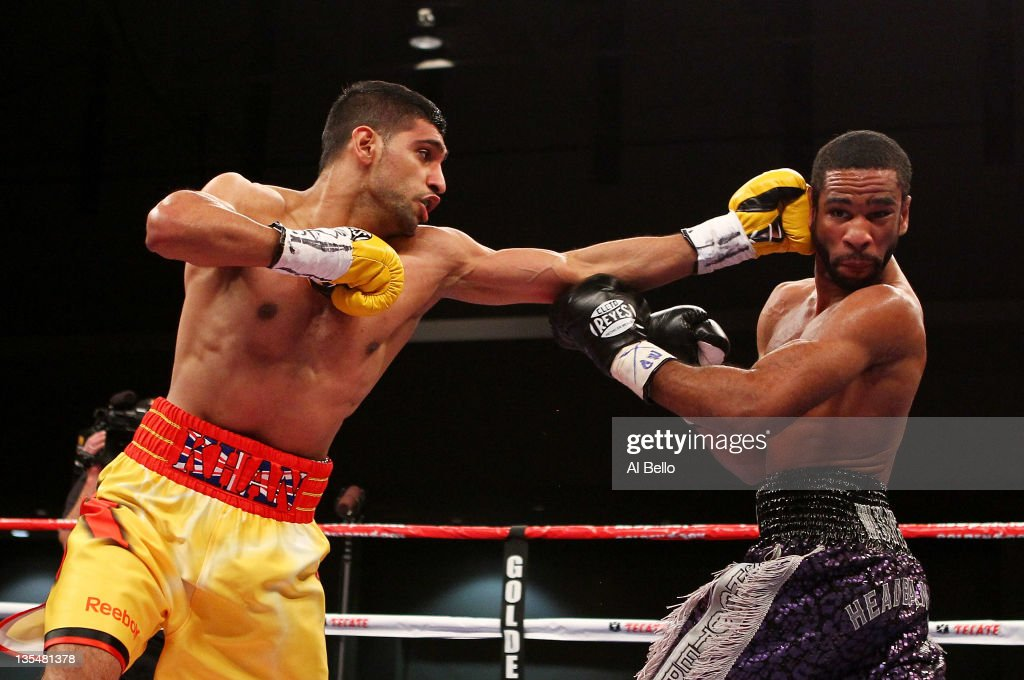 Amir Khan punches Lamont Peterson during their WBA Super Lightweight and IBF Junior Welterweight title fight at Washington Convention Center on...