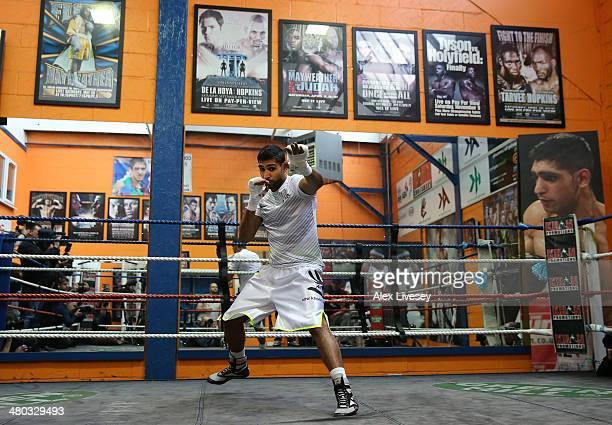 Amir Khan shadow boxes during a media workout at the Gloves Community Centre on March 24 2014 in Bolton England
