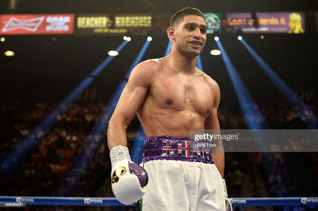 Amir Khan smiles as he heads to his corner while taking on Luis Collazo during their welterweight bout at the MGM Grand Garden Arena on May 3 2014 in...