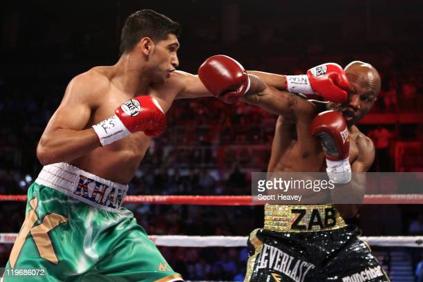 Amir Khan throws a left at Zab Judah in the first round during their super lightweight world championship unification bout at Mandalay Bay Events...