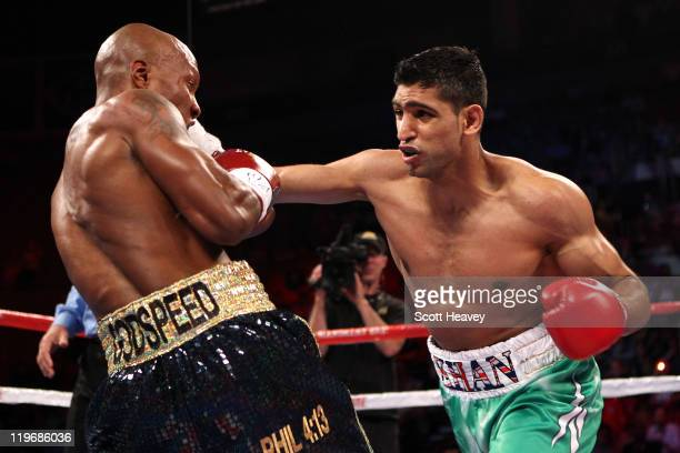 Amir Khan throws a right at Zab Judah in the first round during their super lightweight world championship unification bout at Mandalay Bay Events...