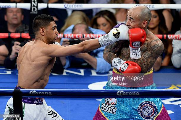 Amir Khan throws a right to the head of Luis Collazo during their welterweight bout at the MGM Grand Garden Arena on May 3 2014 in Las Vegas Nevada