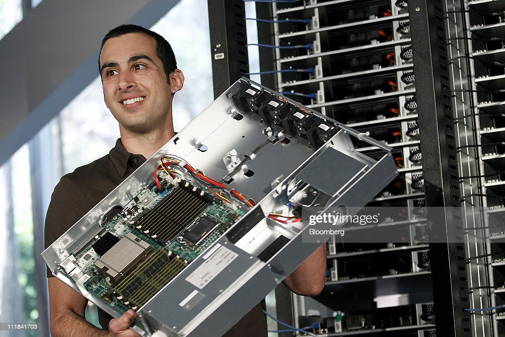 Amir Michael, hardware design manager for Facebook Inc., displays a server while speaking during a news conference at the company's headquarters in Palo Alto, California, U.S., on Thursday, April 7, 2011. Facebook Inc. Chief Executive Officer Mark Zuckerberg plans to share the social-networking site's data-center and server designs with other companies to help the technology industry become more efficient. The effort, called the Open Compute Project, will provide access to technology Facebook developed with Intel Corp., Advanced Micro Devices Inc., Hewlett-Packard Co. and Dell Inc. Photographer: Tony Avelar/Bloomberg via Getty Images
