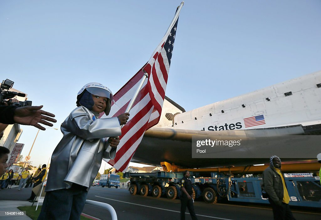 Amir Morris, 3, watches the Space Shuttle Endeavour being moved to the California Science Center on October 13, 2012 in Inglewood, California. The space shuttle Endeavour is on 12-mile journey from Los Angeles International Airport to the California Science Center to go on permanent public display.