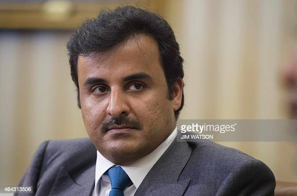 Amir of Qatar Sheikh Tamim bin Hamad al Thani during a bilateral meeting with US President Barack Obama in the Oval Office of White House in...