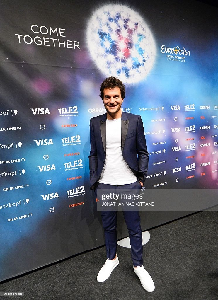 Amir representing France with the song Jai Cherche poses after a press conference after his first rehearsal ahead of the Eurovision Song Contest 2016 in Stockholm, on May 6, 2016. The contest will consist of two semi-finals on 10 and 12 May and the final on 14 May 2016 at the Ericsson Globe in Stockholm. / AFP / JONATHAN
