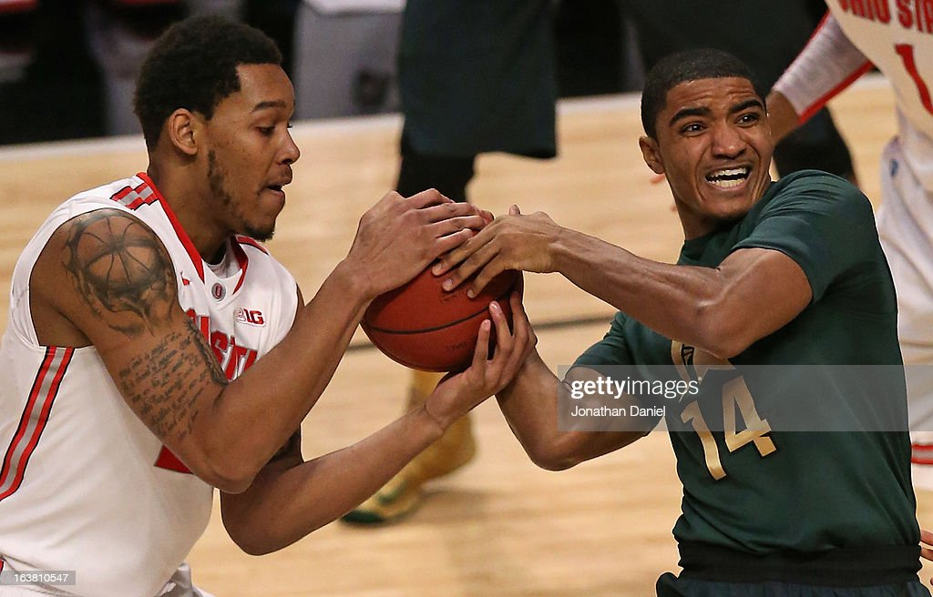 Amir Williams #23 of the Ohio State Buckeyes battles for possession of the ball with Gary Harris #14 of the Michigan State Spartans during a semifinal game of the Big Ten Basketball Tournament at the United Center on March 16, 2013 in Chicago, Illinois.
