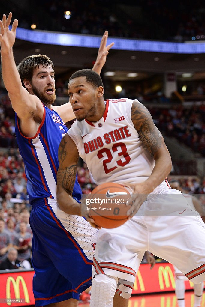 Amir Williams #23 of the Ohio State Buckeyes drives to the basket on Tony Wroblicky #34 of the American University Eagles in the second half on November 20, 2013 at Value City Arena in Columbus, Ohio. Ohio State defeated American 63-52.
