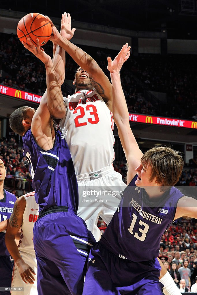 Amir Williams #23 of the Ohio State Buckeyes drives to the basket to score between the defense of Mike Turner #10 and Kale Abrahamson #13 of the Northwestern Wildcats in the second half on February 14, 2013 at Value City Arena in Columbus, Ohio. Ohio State defeated Northwestern 69-59.