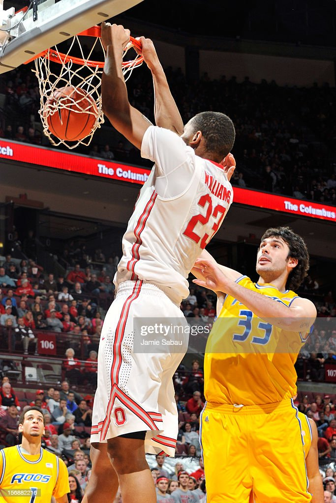 Amir Williams #23 of the Ohio State Buckeyes finishes off a slam dunk over Brad Reid #33 of the Missouri-Kansas City Roos in the second half on November 23, 2012 at Value City Arena in Columbus, Ohio. Ohio State defeated UMKC
