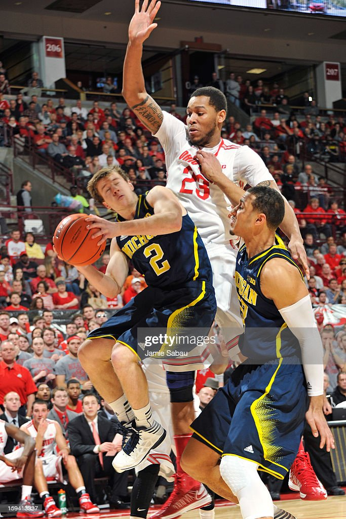 Amir Williams #23 of the Ohio State Buckeyes fouls Spike Albrecht #2 of the Michigan Wolverines as Albrecht drives to the basket in the first half on January 13, 2013 at Value City Arena in Columbus, Ohio.