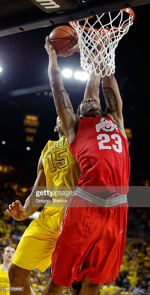 Amir Williams #23 of the Ohio State Buckeyes gets a second half shot off in front of Jon Horford #15 of the Michigan Wolverines at Crisler Center on February 5, 2013 in Ann Arbor, Michigan. Michigan won the game 76-74 in overtime.