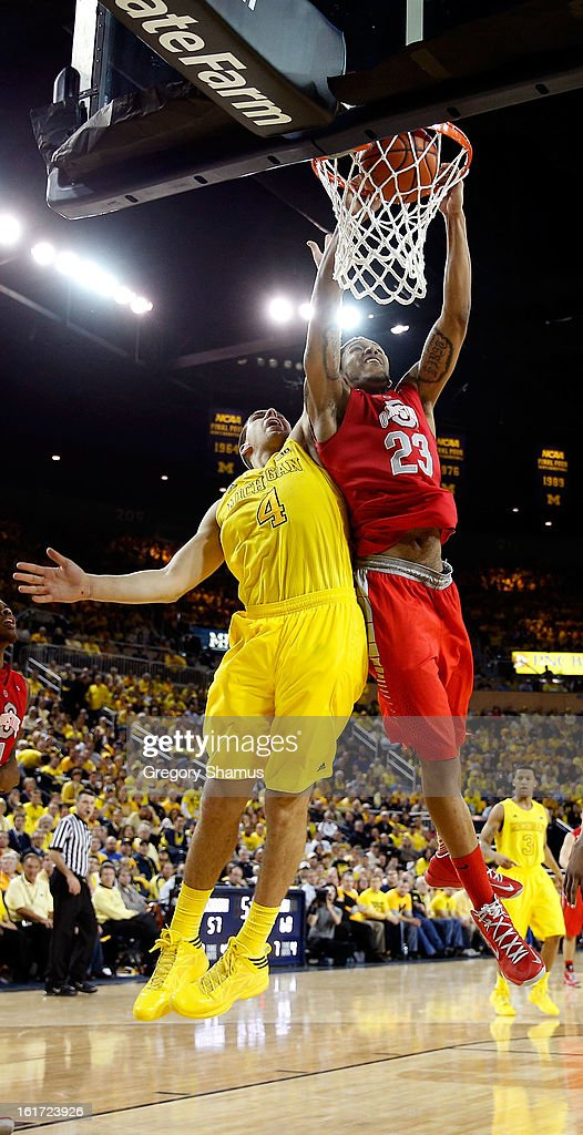 Amir Williams #23 of the Ohio State Buckeyes gets in for a second half dunk next to Mitch McGary #4 of the Michigan Wolverines at Crisler Center on February 5, 2013 in Ann Arbor, Michigan. Michigan won the game 76-74 in overtime.