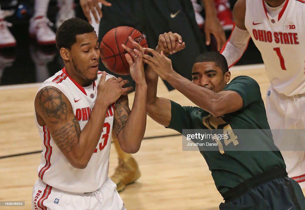 Amir Williams #23 of the Ohio State Buckeyes grabs the ball from Gary Harris #14 of the Michigan State Spartans during a semifinal game of the Big Ten Basketball Tournament at the United Center on March 16, 2013 in Chicago, Illinois. Ohio State defeats Michigan State 61-58.
