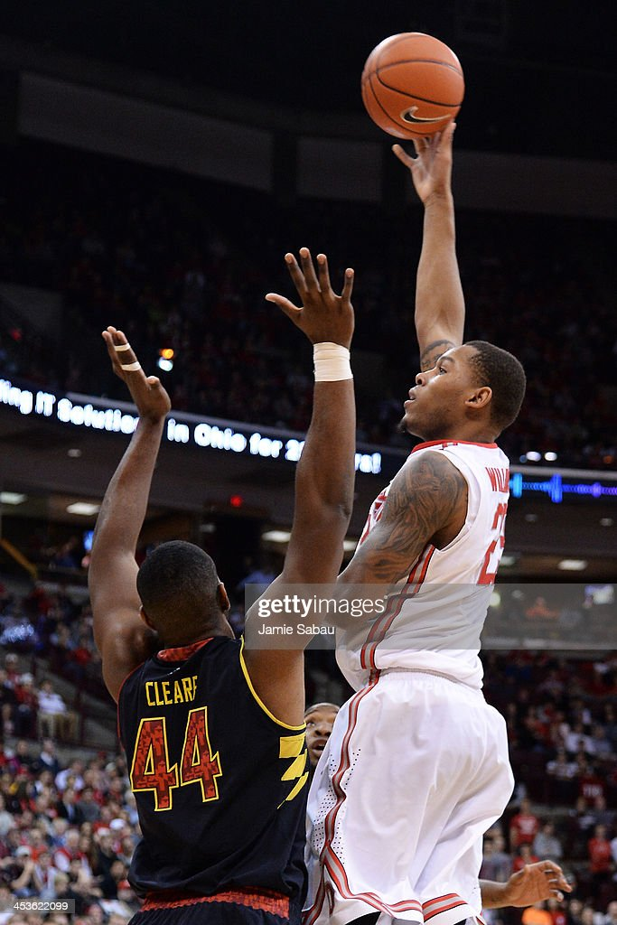 Amir Williams #23 of the Ohio State Buckeyes puts up a shot over the defense of Shaquille Cleare #44 of the Maryland Terrapins in the second half on December 4, 2013 at Value City Arena in Columbus, Ohio. Ohio State defeated Maryland 76-60.