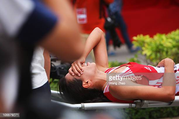Amira Ben Amor of Tunsinia is stretchered off injured from the field after the IAAF World Half Marathon Championships 2010 on October 16 2010 in...