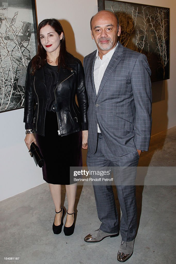 Amira Casar (L) and Christian Louboutin attend the opening of Thaddaeus Ropac's new gallery on October 13, 2012 in Pantin, France.