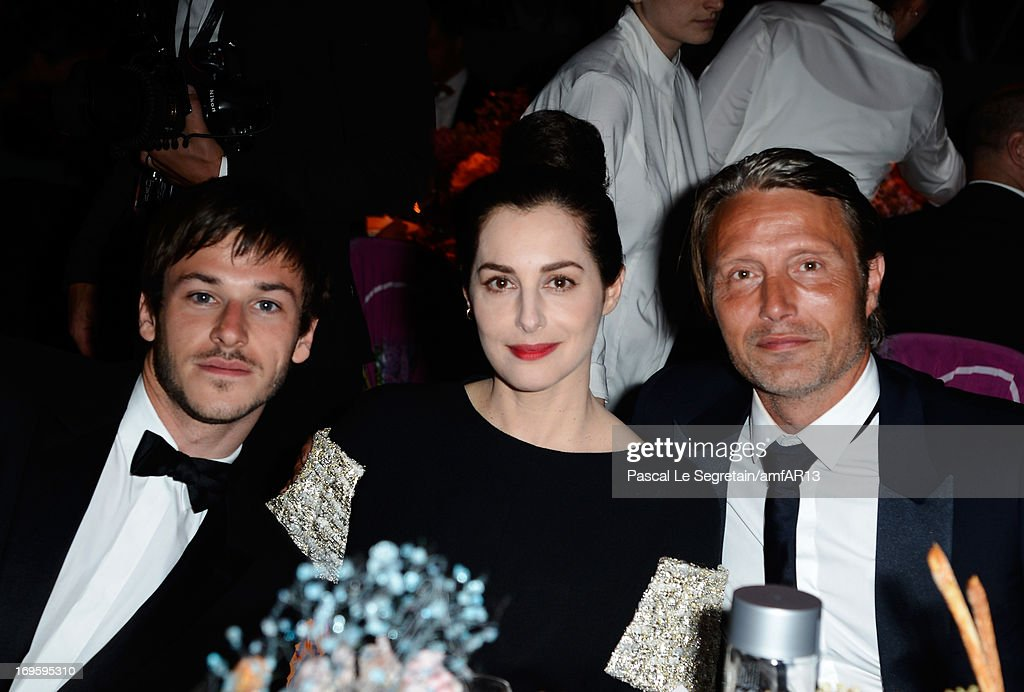 Amira Casar, Gaspard Ulliel and Mads Mikkelsen attend the Gala Dinner for amfAR's 20th Annual Cinema Against AIDS at Hotel du Cap-Eden-Roc on May 23, 2013 in Cap d'Antibes, France.