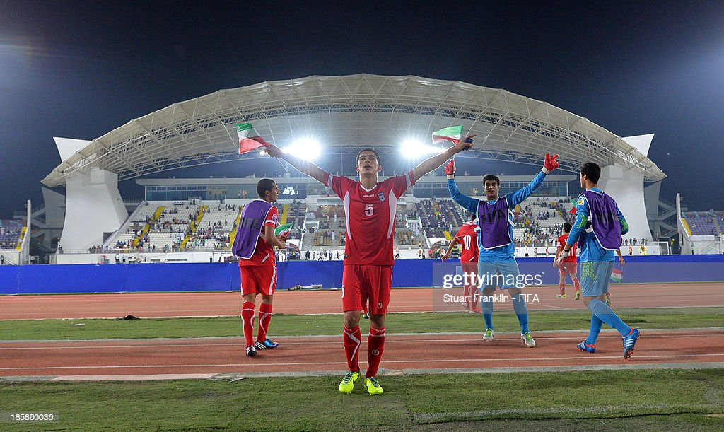 Amirhossein Bazaj of Iran celebrates at the end of the FIFA U 17 World Cup group E match between Austria and Iran at Khalifa Bin Zayed Stadium on October 25, 2013 in Al Ain, United Arab Emirates.