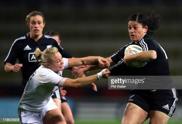 Amiria Rule of the Black Ferns is tackled by Fran Matthews of England during game two of the international series between the New Zealand Black Ferns...