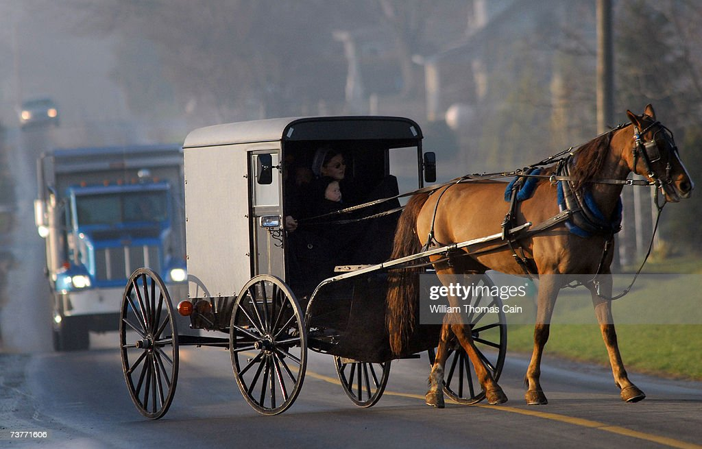 Amish children arrive via horse and buggy to their newly built schoolhouse April 2 2007 in Nickel Mines Pennsylvania The school opened six months...