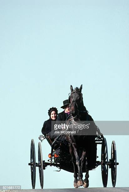 Amish Couple Traveling Country Road