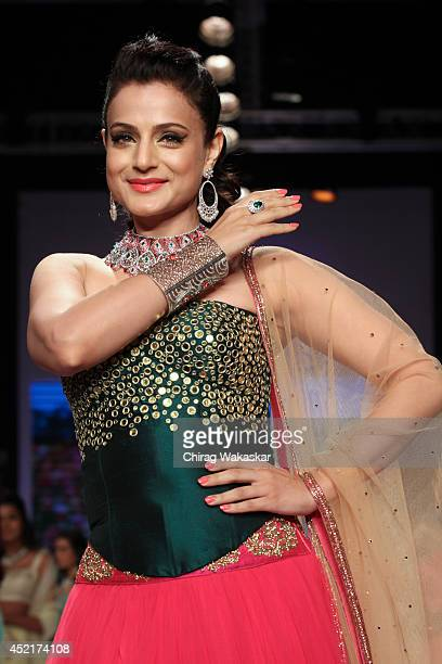 Amisha Patel walks the runway at the Surya Gold show during day 1 of the India International Jewellery Week 2014 at grand Hyatt on July 14 2014 in...