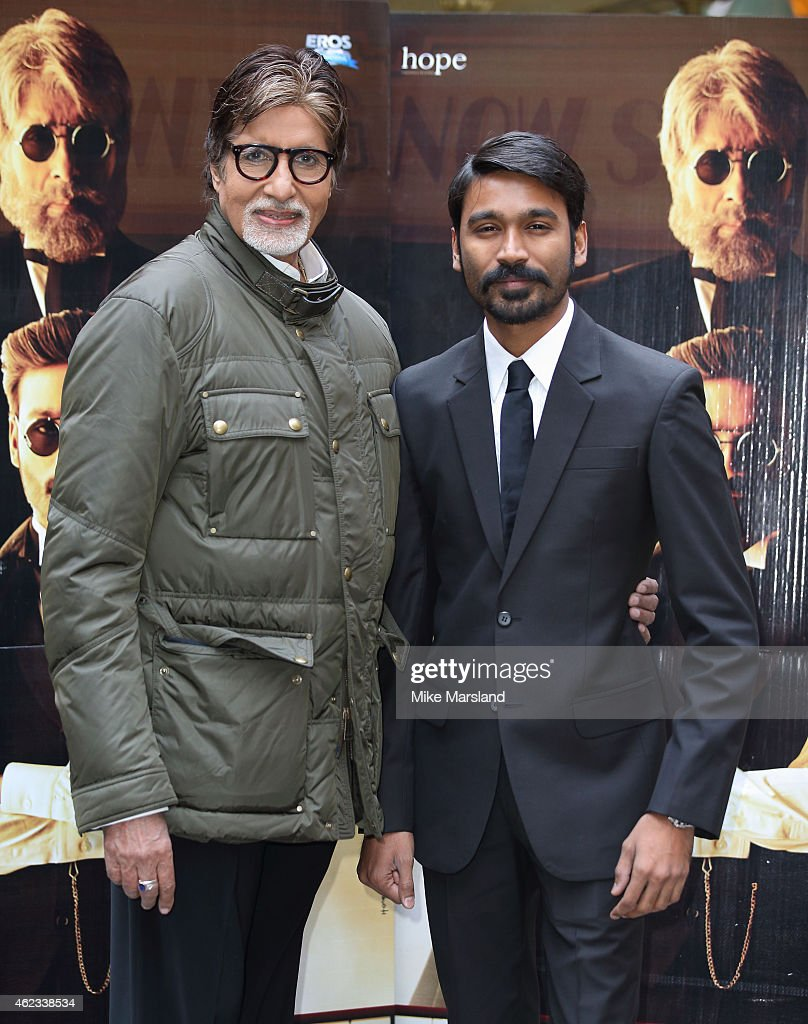 <a gi-track='captionPersonalityLinkClicked' href=/galleries/search?phrase=Amitabh+Bachchan&family=editorial&specificpeople=220394 ng-click='$event.stopPropagation()'>Amitabh Bachchan</a> and Dhanush attend a photocall for 'Shamitabh' at St James Court Hotel on January 27, 2015 in London, England.