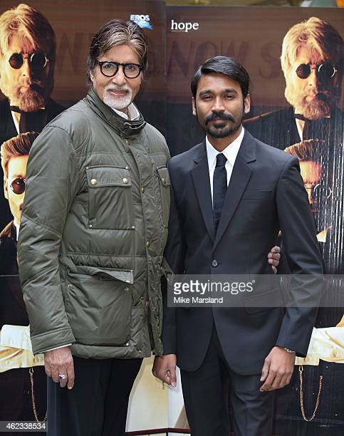 Amitabh Bachchan and Dhanush attend a photocall for 'Shamitabh' at St James Court Hotel on January 27 2015 in London England