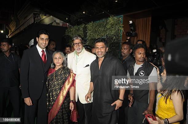 Amitabh Bachchan with his wife Jaya son Abhishek and host Sunil Shetty on the launch of Sunil's new store R house on January 12 2013 in Mumbai India