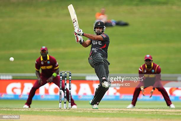 Amjad Ali of the UAE plays a shot during the 2015 ICC Cricket World Cup match between the West Indies and United Arab Emirates at McLean Park on...