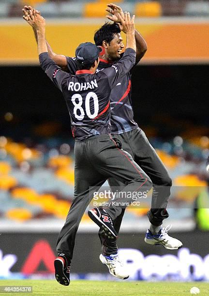 Amjad Javed of the United Arab Emirates celebrates with Rohan Mustafa after taking the wicket of Ed Joyce of Ireland during the 2015 ICC Cricket...