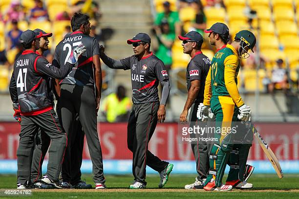 Amjad Javed of the United Arab Emirates is congratulated by teammates after taking the wicket of Quinton de Kock of South Africa during the 2015 ICC...