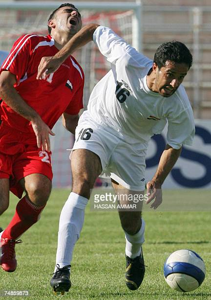 CORRECTING THE FINAL SCORE IN THE CAPTION Iraq's player Ahmad Abbas vies with Syrian midfielder Mootassem Alaya during their West Asian Football...