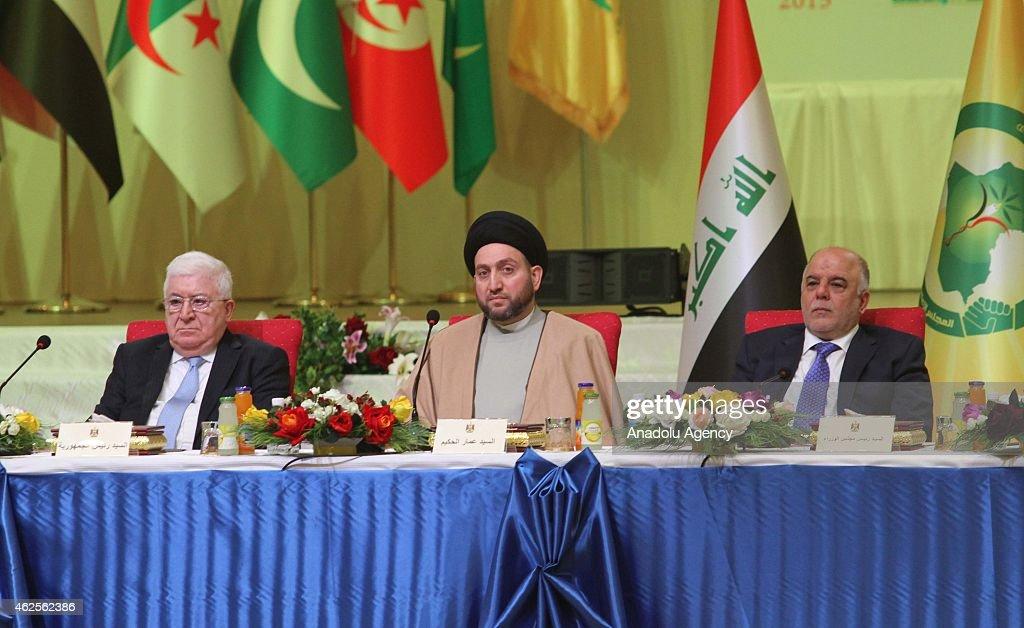 Ammar alHakim President of the Islamic Supreme Iraqi president Fuad Masum and Iraqi Prime minister Haider alAbadi attend the interfaith dialogue...