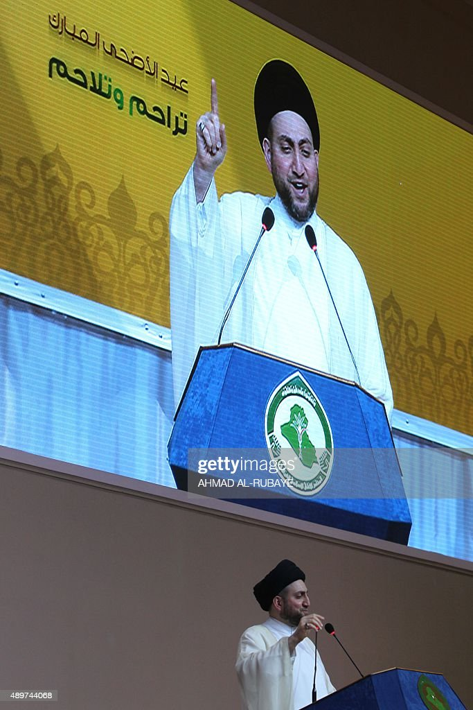 Ammar alHakim the leader of Iraq's Shiite Muslim Supreme Iraqi Islamic Council addresses worshippers from the podium with the slogan 'Compassion and...