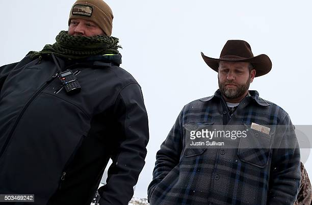 Ammon Bundy the leader of an antigovernment militia walks back to the Malheur National Wildlife Refuge Headquarters after speaking to members of the...