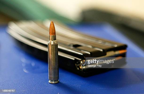 AR15 ammunition and a high capacity 30 round clip sits on the table at the 'Get Some Guns Ammo' shooting range on January 15 2013 in Salt Lake City...