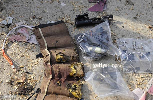 Ammunition including a grenade launcher a gun and part of the exploded vest of the suicide attacker is pictured at the scene of a suicide attack in...