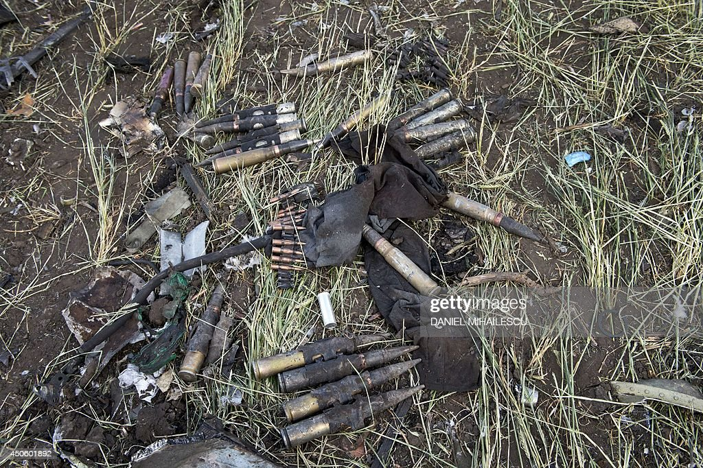 Ammunition lies among the debris of an IL76 Ukrainian military transporter which was taken down by proRussian rebels early on June 14 on the...