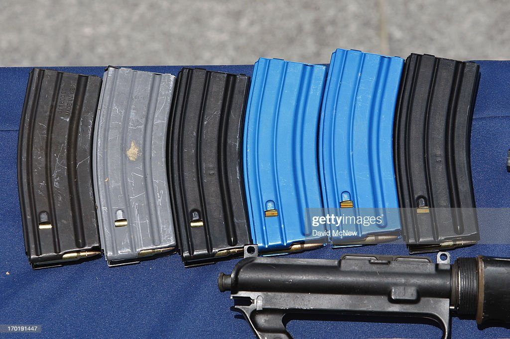 Ammunition magazines allegedly dropped by a gunman during a mass shooting spree at Santa Monica College are displayed at the Santa Monica Police Department headquarters on June 8, 2013 in Santa Monica, California. The shootings occurred in various locations about three miles south of a political fundraiser attended by President Barack Obama but Secret Service officials said the two events were not related and that the president was never in any danger. Four people besides the gunman have died from their wounds and five others wounded, including a woman who is close to death.
