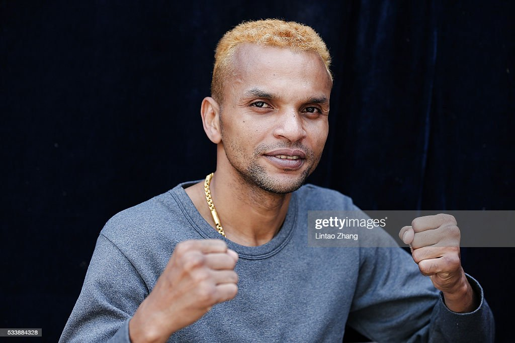 <a gi-track='captionPersonalityLinkClicked' href=/galleries/search?phrase=Amnat+Ruenroeng&family=editorial&specificpeople=4607245 ng-click='$event.stopPropagation()'>Amnat Ruenroeng</a> of Thailand attends the Great Wall Weigh-in of IBF World Boxing Championship Bout at Mutianyu on May 24, 2016 in Beijing, China.
