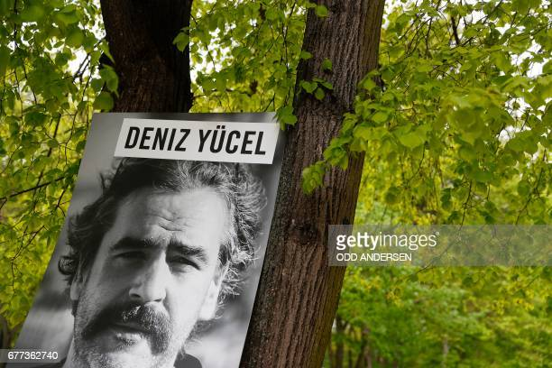 Amnesty International activists have installed the portrait of GermanTurkish journalist Deniz Yucel who is detained in Turkey in front of the Turkish...