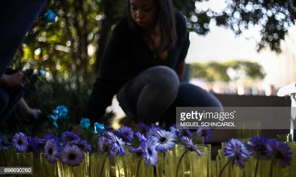 Amnesty International activists place flowers outside the Russian Consulate in protest against the persecution of gay men in Chechnya in Sao Paulo...