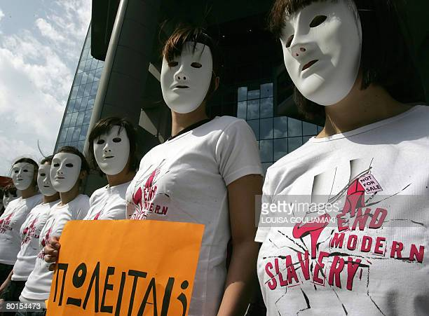 Amnesty International activists wearing Tshirts reading 'end modern slavery' protest against human trafficking near the Ministry of Justice in Athens...