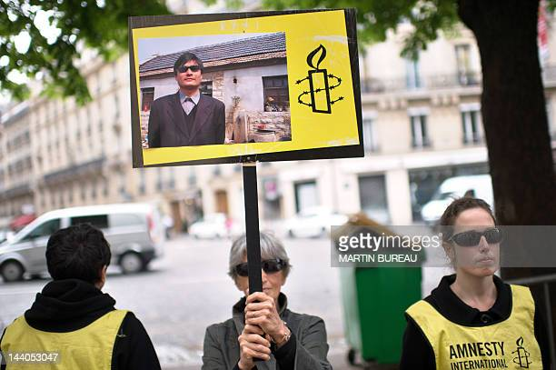 Amnesty International activits take part in a protest in support of blind Chinese activist Chen Guangcheng on May 9 2012 in front of the China's...