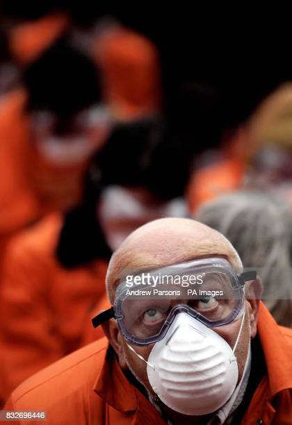 Amnesty International demonstrators in orange boiler suits protest outside the US Embassy in Grosvenor Square London to mark the fifth anniversary of...