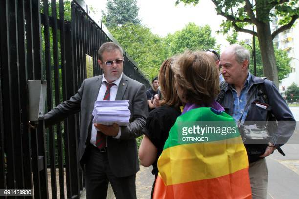 Amnesty International militants hand hundreds of signed petitions denouncing persecution against the LGBT community in Chechnya to an official of the...